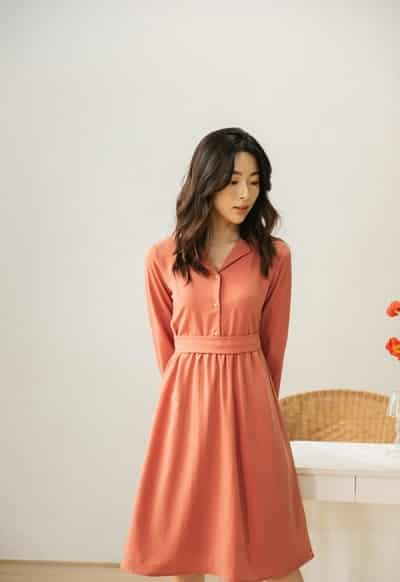 Váy sơ mi màu cam ấm áp rất phù hợp để các nàng diện trong ngày đầu đi làm của năm mới